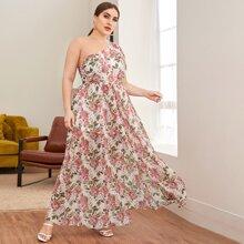 Kleid mit einer Schulter und ueberallen Blumen Mustern
