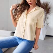 Einfarbige Bluse mit Knopfen und Taschen Klappe
