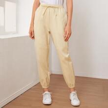 Pantalones conicos con bolsillo con cremallera de cintura con nudo