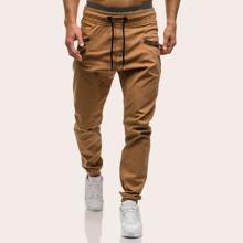 Pantalones de hombres con diseño de camuflaje de cintura con cordon