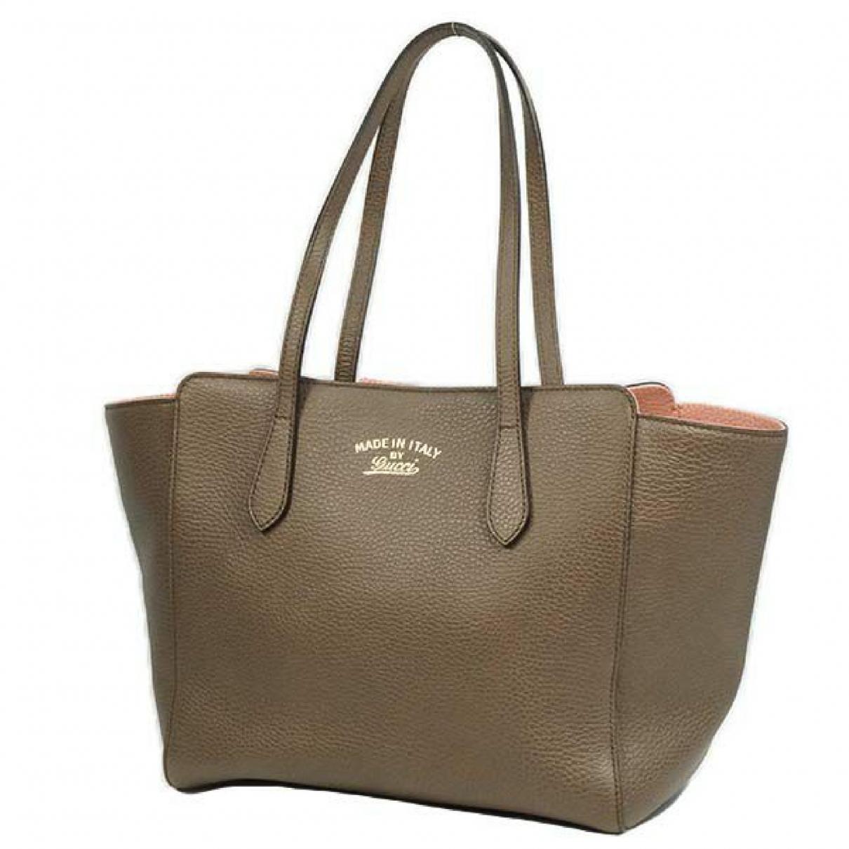 Gucci \N Handtasche in  Khaki Leder
