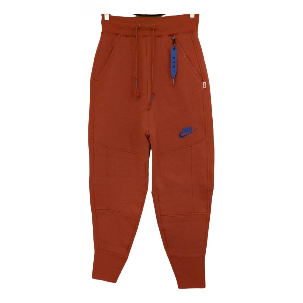 Nike - Pantalon   pour femme en elasthane - orange