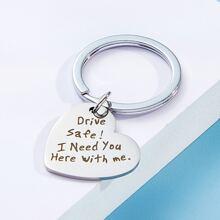 Llavero con diseño de corazon con diseño de slogan