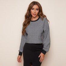 Sweatshirt mit Hahnentritt Muster und sehr tief angesetzter Schulterpartie