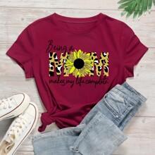 Camiseta con estampado floral con slogan