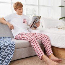 Conjunto de pijama camiseta tapeta media con boton con pantalones de cuadros