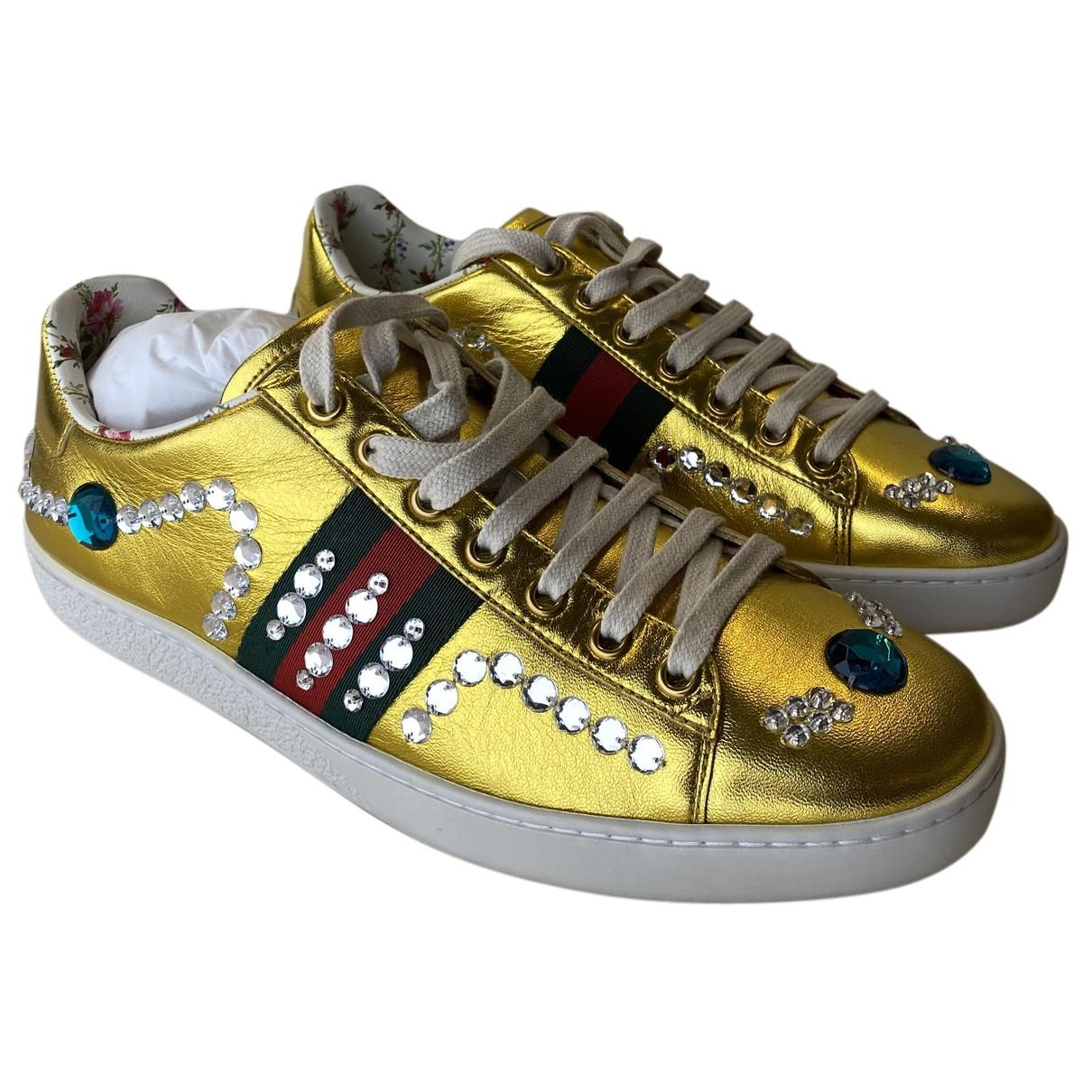 Gucci \N Sneakers in  Gold Leder