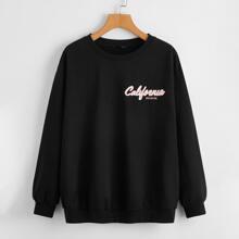 Pullover mit Buchstaben & tropischem Muster und sehr tief angesetzter Schulterpartie