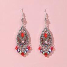 Ohrringe mit Lochern und Kristall Dekor