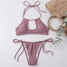 Bañador bikini tanga con cordon lateral con abertura