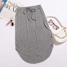 Falda irregular de cintura con nudo