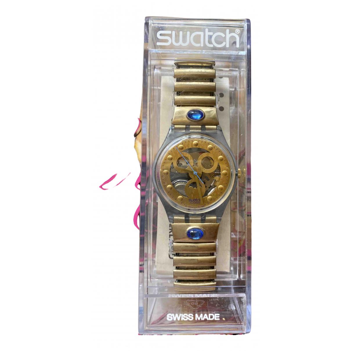 Swatch - Montre   pour femme en autre - dore