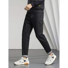 Men Solid Ripped Tapered Jeans