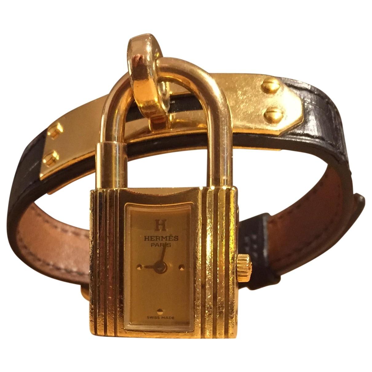 Hermes - Montre Kelly pour femme en plaque or - noir