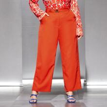 Neon orange Hose mit Guertel und breitem Beinschnitt