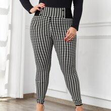 Skinny Hose mit Hahnentritt Muster und zweireihigen Knopfen