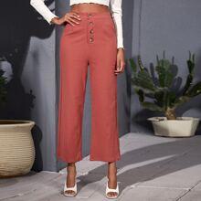 Einfarbige Hose mit Knopfen vorn und breitem Beinschnitt