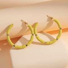 Maedchen Kreolen mit Perlen