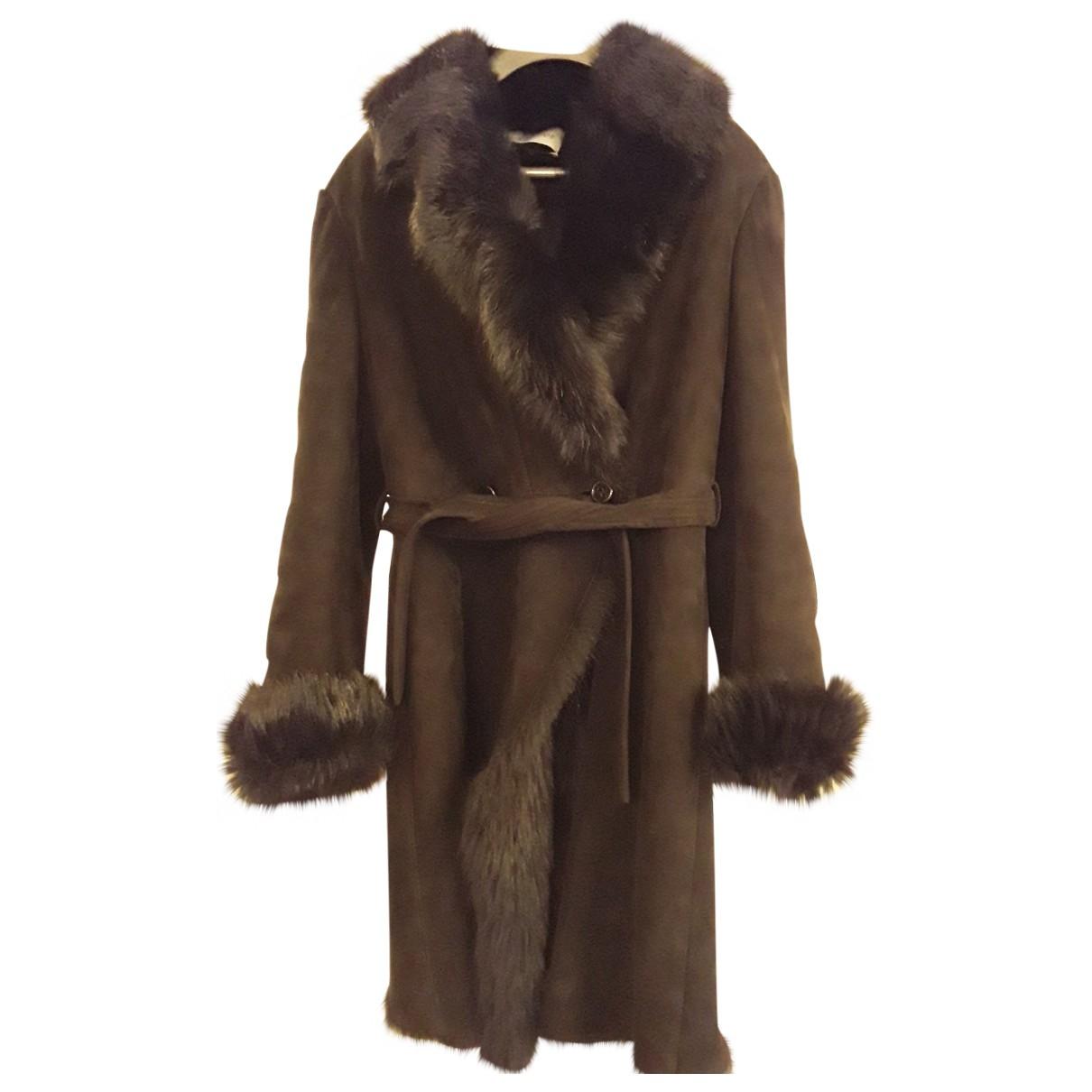 Yves Saint Laurent - Manteau   pour femme en fourrure - noir