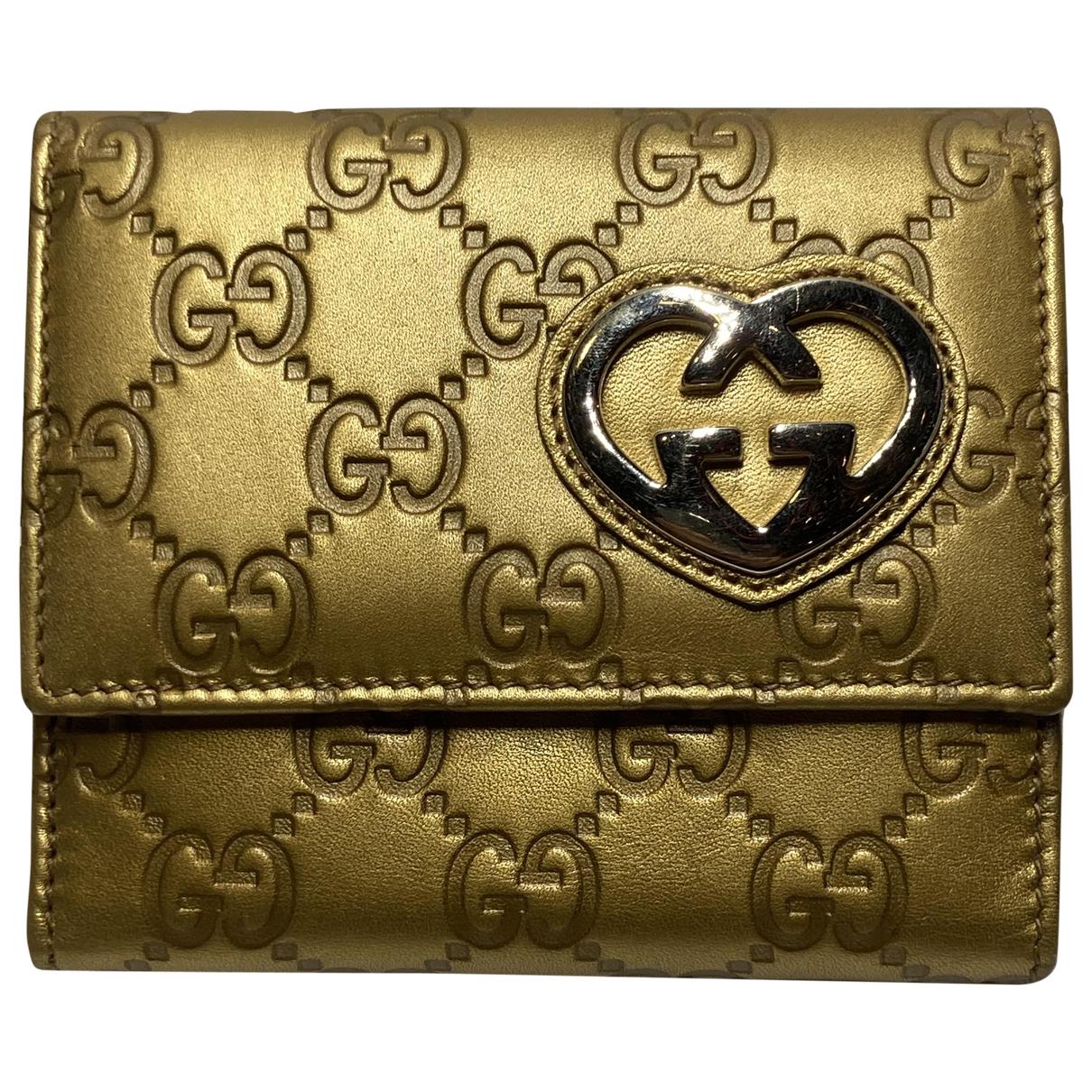 Gucci \N Portemonnaie in  Gold Leder