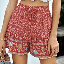 Shorts mit ueberallem Blumen Muster und Kordelzug um die Taille