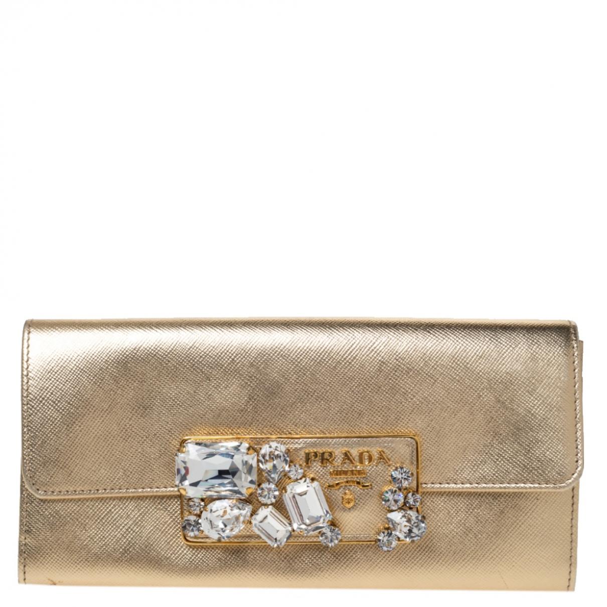 Prada - Portefeuille   pour femme en cuir - dore