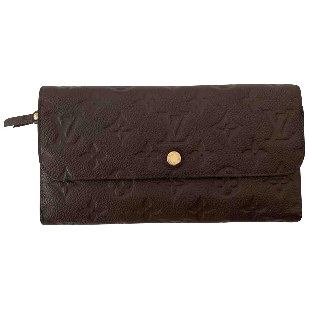 Louis Vuitton - Portefeuille Virtuose pour femme en cuir - marron