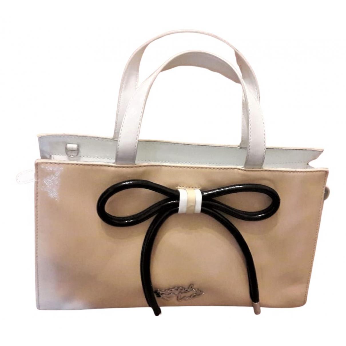 Non Signe / Unsigned \N Handtasche in Lackleder