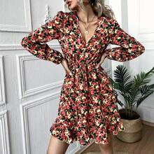 Kleid mit Blumen Muster und Schosschenaermeln