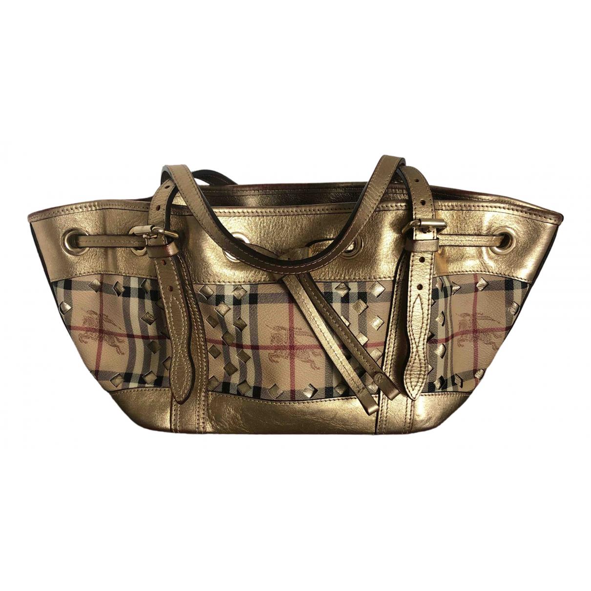 Burberry N Gold Cloth handbag for Women N