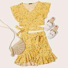 Conjunto top floral de margarita con cordon delantero cruzado con tiras cruzadas con falda