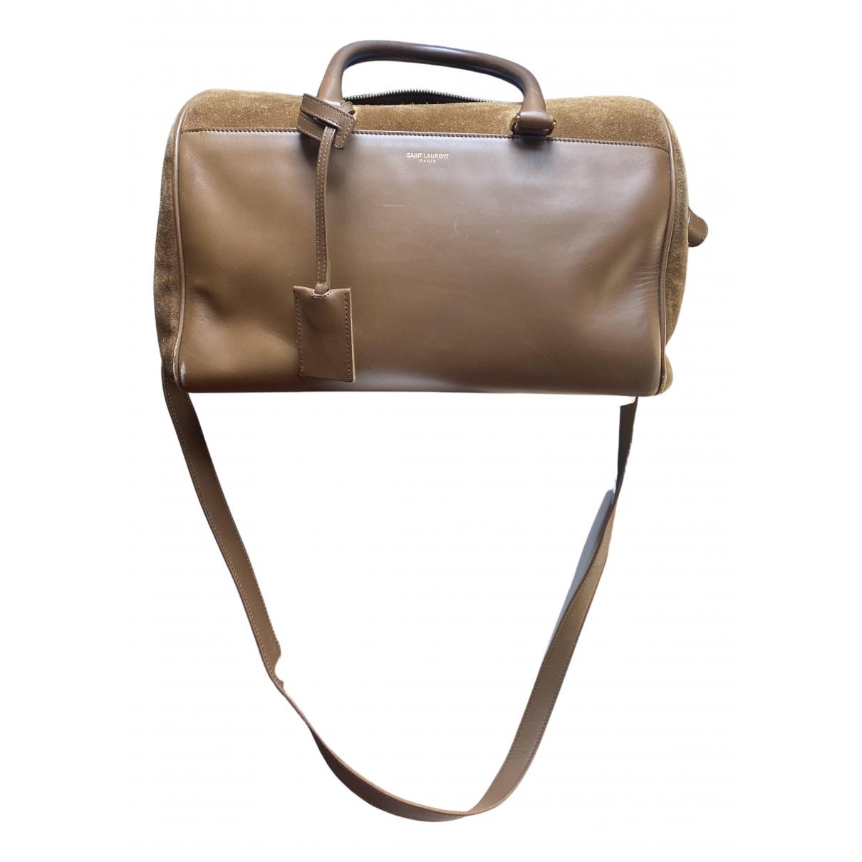 Saint Laurent Duffle Handtasche in  Kamel Veloursleder
