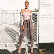 Pantalones ajustados con cinturon de cintura con volante