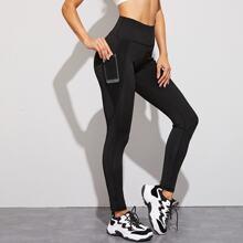 Leggings de cintura alta con bolsillo con malla en contraste