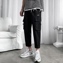 Men Drawstring Hem Flap Pocket Cargo Pants