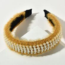 Aro de pelo mullido con perla artificial
