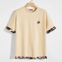 Ringer T-Shirt mit sehr tief angesetzter Schulterpartie