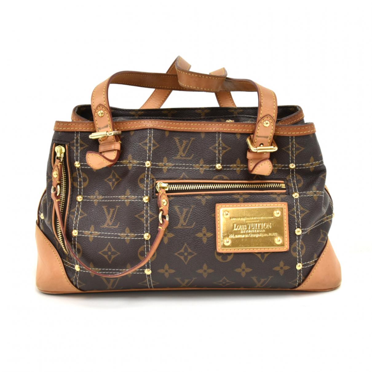 Louis Vuitton Rivets Brown Cloth handbag for Women N