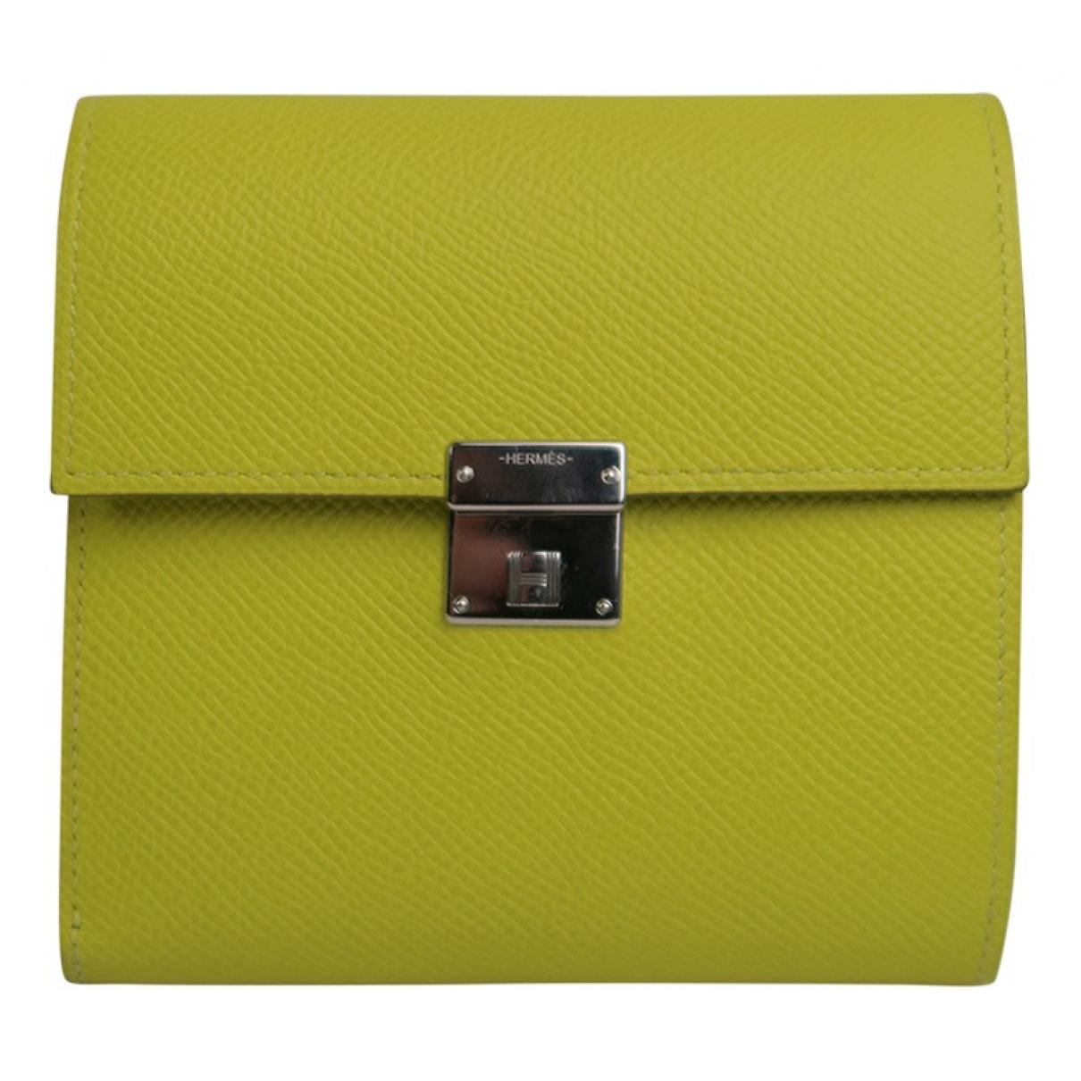 Hermes Clic 12 Portemonnaie in  Gelb Leder