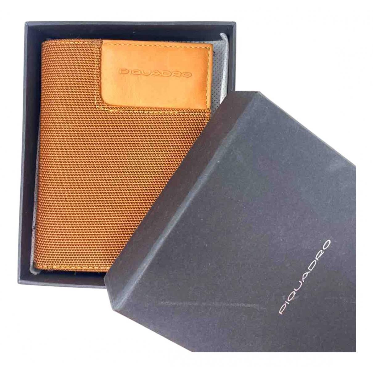 Piquadro - Portefeuille   pour femme en cuir - orange