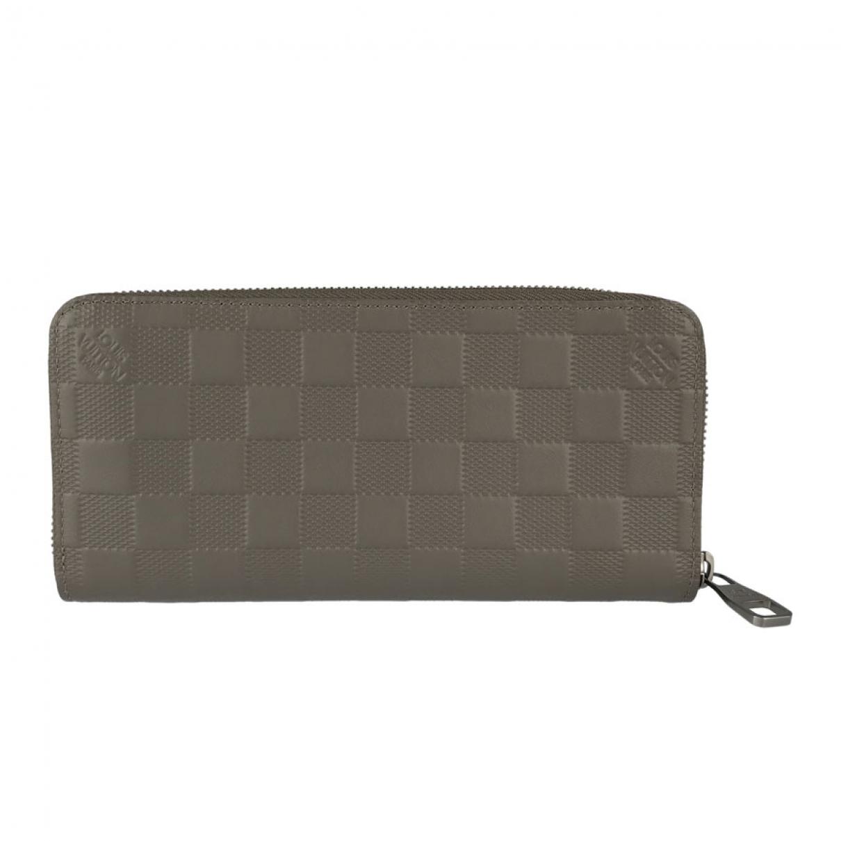 Louis Vuitton - Portefeuille Zippy pour femme en cuir - gris