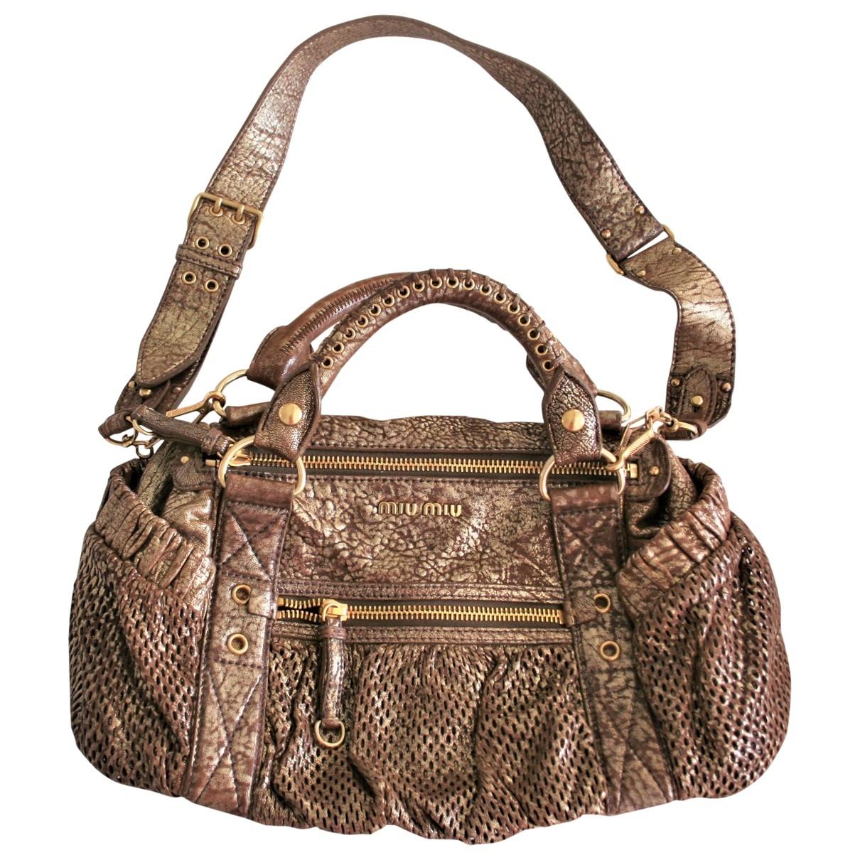 Miu Miu \N Gold Leather handbag for Women \N