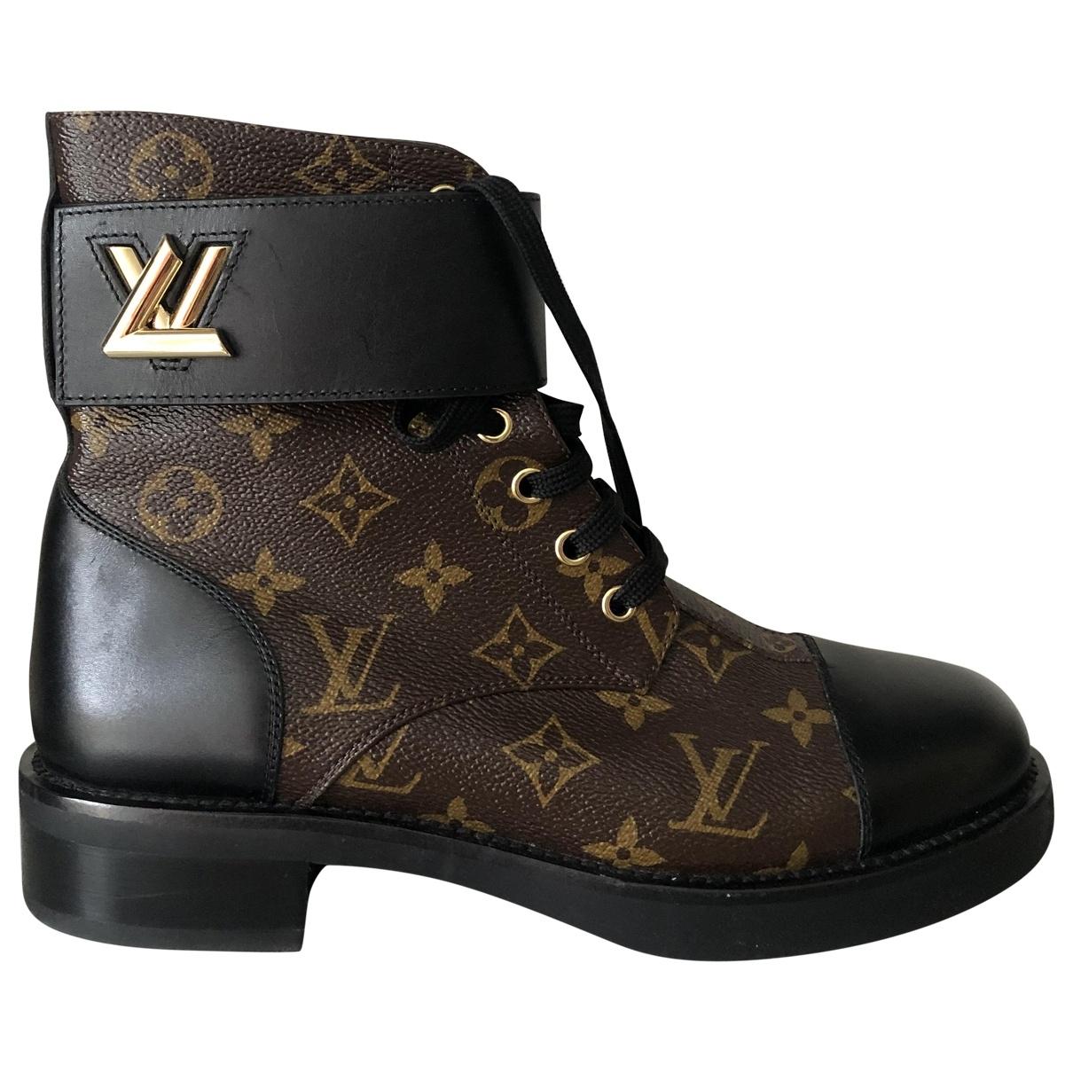 Louis Vuitton Wonderland Stiefeletten in  Braun Leinen