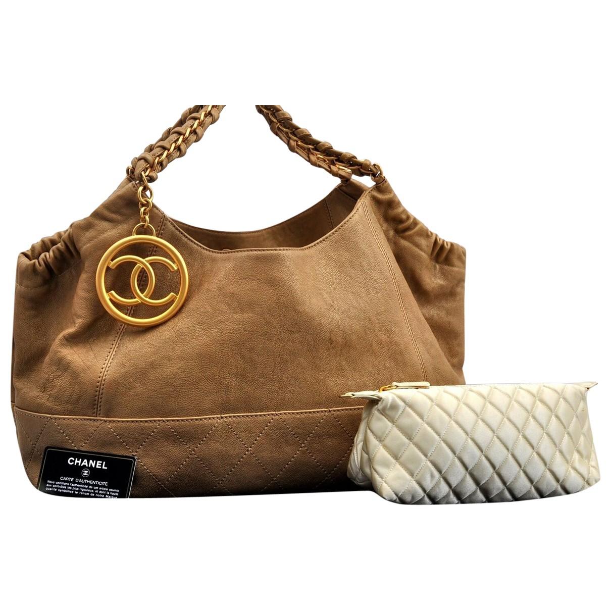 Chanel - Sac a main Coco Cabas pour femme en cuir - dore