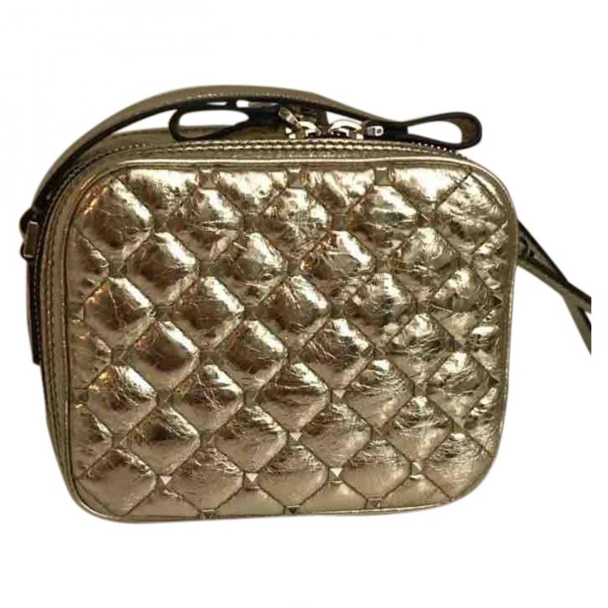 Valentino Garavani Rockstud spike Gold Leather handbag for Women \N