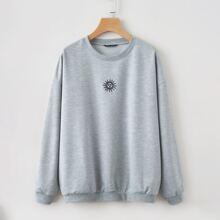 Sweatshirt mit Sonne Stickereien und sehr tief angesetzter Schulterpartie