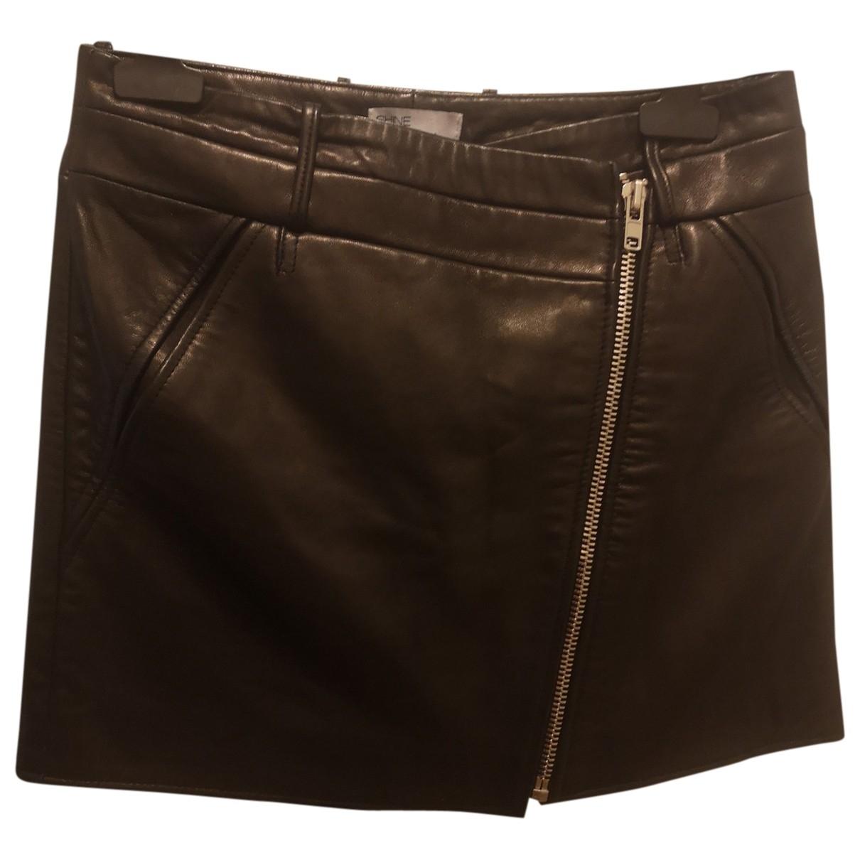 Shine Blossom \N Black Leather skirt for Women 36 FR