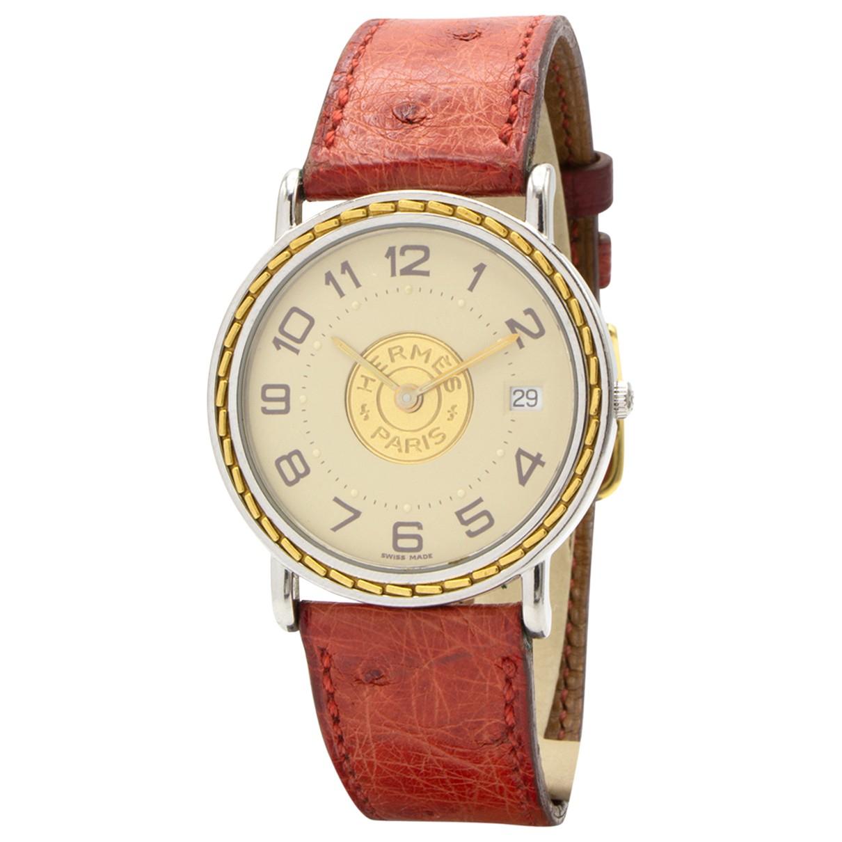 Hermes - Montre Sellier pour femme en or et acier - rouge