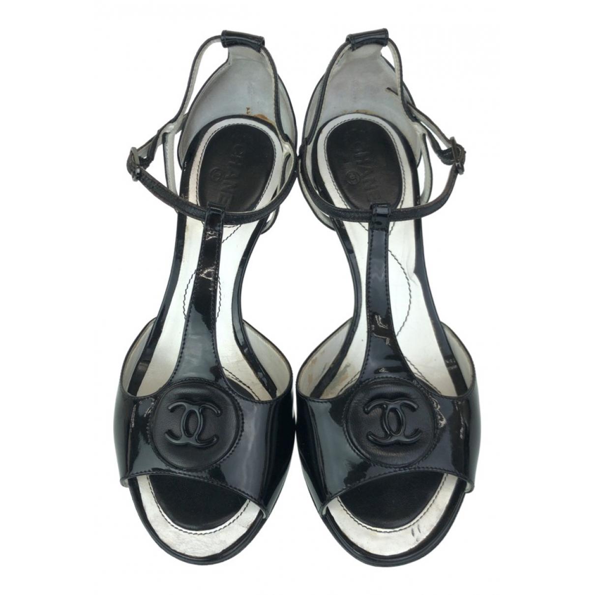 Chanel - Sabots   pour femme en cuir verni - noir