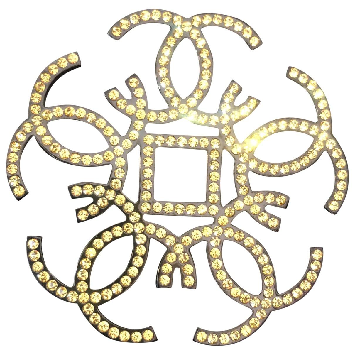 Chanel - Broche   pour femme en metal - jaune